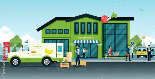Delivery trucks bring vegetables and fruit delivered to the supermarket.