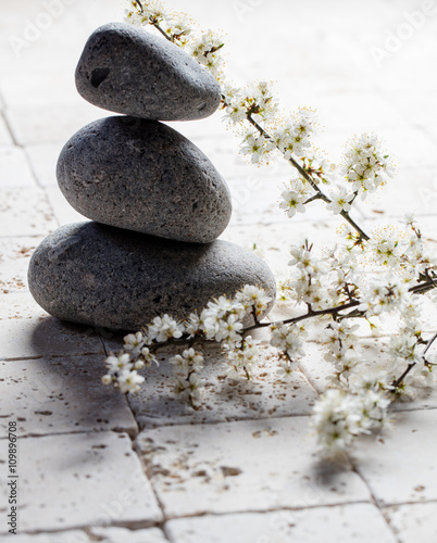 pebbles in balance with zen spring flowers for meditation