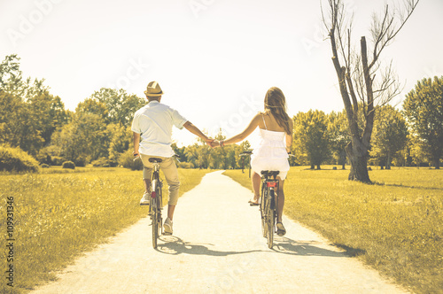Couple of romantic lovers cycling