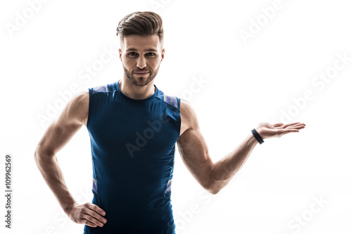 Cheerful male athlete is making a presentation