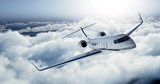 Fototapety Realistic photo of White Luxury generic design private jet flying over the earth. Empty blue sky with white clouds at background. Business Travel Concept. Horizontal. 3d rendering
