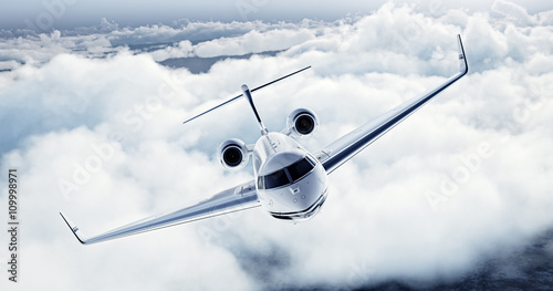 Fototapeta Realistic image of White Luxury generic design private airplane flying over the earth. Empty blue sky with white clouds at background. Business Travel Concept. Horizontal. 3d rendering
