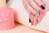 Fototapety Manicure - Beautifully manicured woman fingernails. Feminine nail art with interesting animal print nail art.