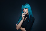 Fototapety Portrait of a young woman with a cyan color hair
