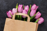 Fresh purple tulip flowers bag