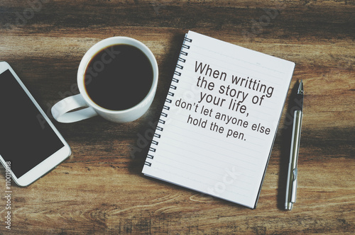 Smart phone, coffee, pen and notepad with text