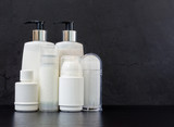 Six Beauty Products on a Black Table