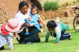 Aymara family - mother and her three children - 110041578