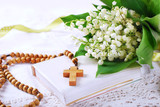 the first holy communion with rosary and flowers - 110052514