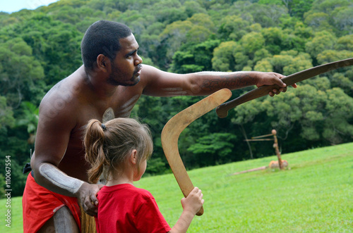 Poster Yirrganydji Aboriginal warrior teaches a little girl how to thro