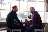 Fototapety  Two Male Friends Meeting In Coffee Shop