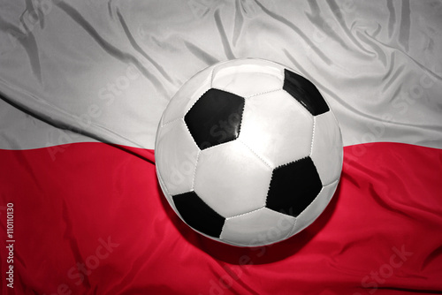 Poster black and white football ball on the national flag of poland