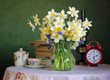 Still life with a bouquet of daffodils in glass jug