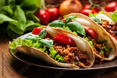 Poster Mexican tacos with minced meat, beans and spices