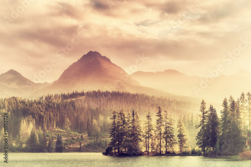 Vintage Sunset over a Lake in Mountains - 110153726