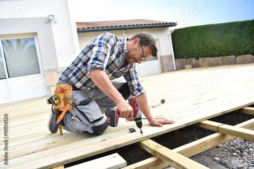 Foto Murales Carpenter building wooden deck