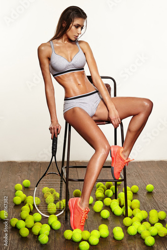 beautiful fitness sexy woman, tennis player with racket Poster