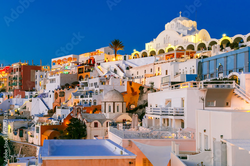Foto op Canvas Fira, modern capital of the Greek Aegean island, Santorini, with Orthodox Metropolitan Cathedral, during twilight blue hour, Greece