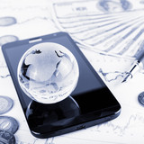 business concept of glass globe, smart phone, coins, pen and mon