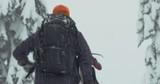 Snowboarder Hiking in Deep Fresh Powder Snow