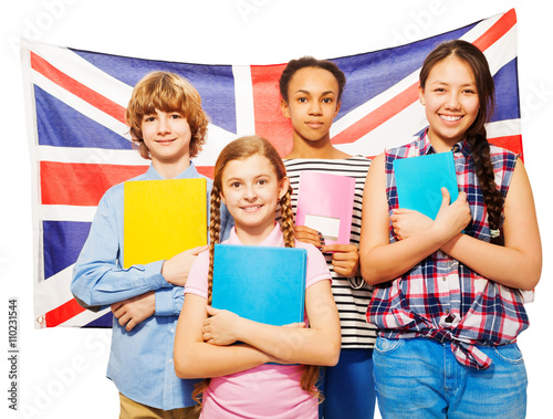 Poster Four happy students standing against British flag