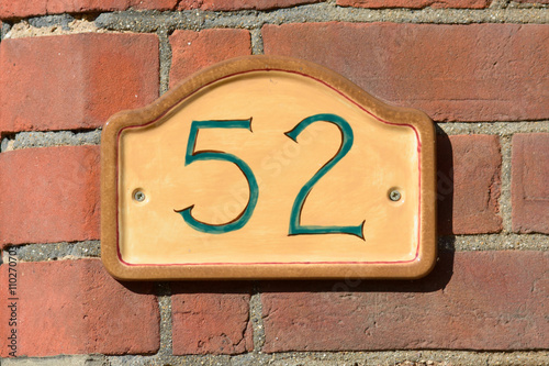 Poster House Number 52 sign on wall