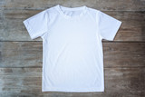 Fototapety Top view of color T-Shirt on grey wood plank