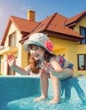 Children swim outdoors.