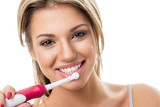 Fototapety Smiling girl with electric toothbrush