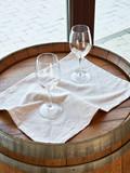 Empty wine glasses on wooden barrel