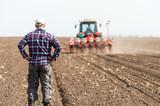 young farmer on farmland - 110381147