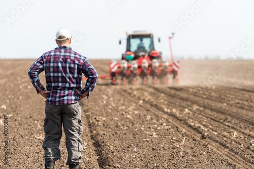young farmer on farmland Poster