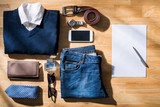 Clothes and accessories of businessman on table