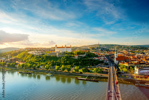 Bratislava aerial cityscape view on the old town with Saint Martin's cathedral, castle hill and Danube river on the sunset in Slovakia Poster