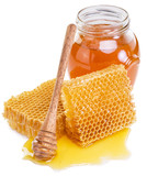 Jar full of fresh honey and honeycombs. High-quality picture.