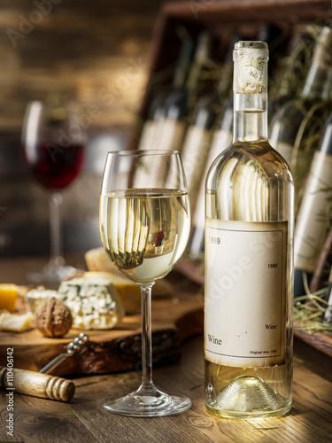 Wine bottles on the wooden shelf. Plakat