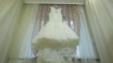 Wedding dress hanging on cornice in the room