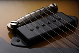 Closeup of old electric guitar. Detail, selective focus.