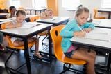 Pupils studying at at their desk