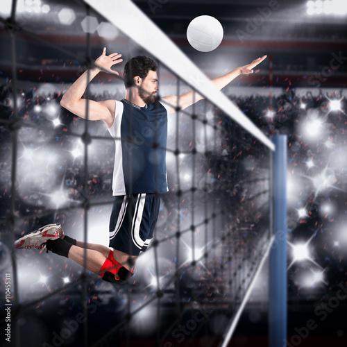 Fototapeta Volleyball player hits the ball