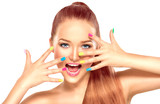 Fototapety Beauty girl with colorful manicure and fashion makeup
