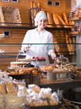 Female staff in local bakery.