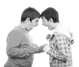 Two teenage boys screaming, yelling and fighting