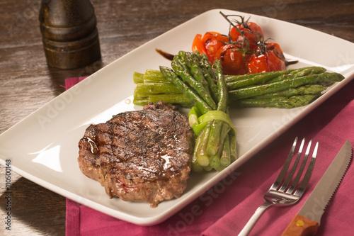 Fototapeta Grilled beef tenderloin with vegetables