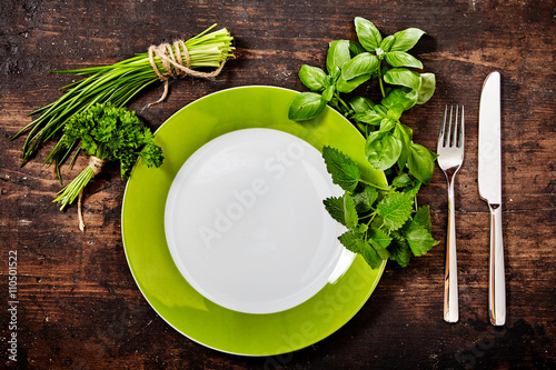 Healthy fresh green herbal place setting