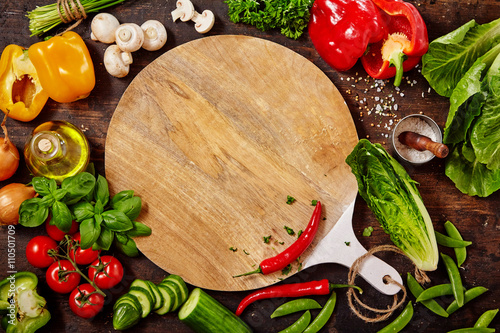 Cutting Board, Fresh Vegetables and Herbs on Table
