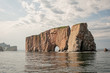 Rocher Percé is a massive rock formation emerging out of the Gulf of St. Lawrence.