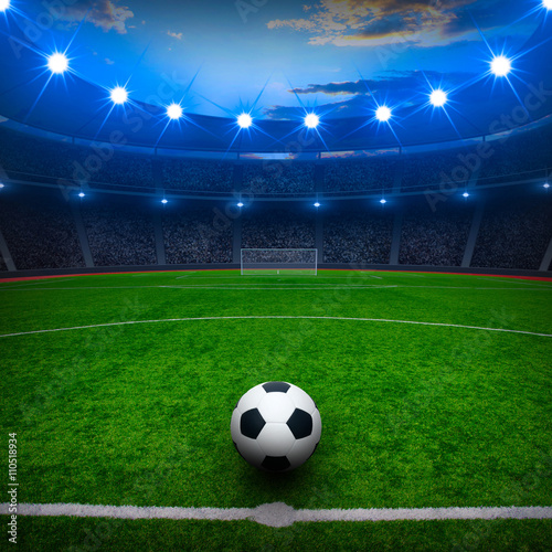 Soccer ball on green stadium