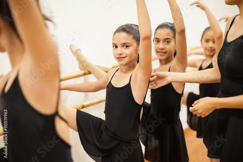 Pretty girl enjoying her ballet class at school