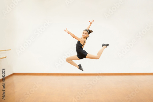 Girl practicing some jumps in dance class